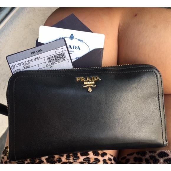 91d15cef81c3 Authentic, Black, Prada Saffiano Zip-Around Wallet.  M_5b2428e69539f7cdb1df7321
